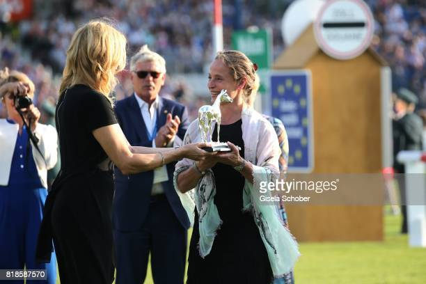 Veronica Ferres gives the award 'silver horse' to Isabell Werth during the media night of the CHIO 2017 on July 18 2017 in Aachen Germany