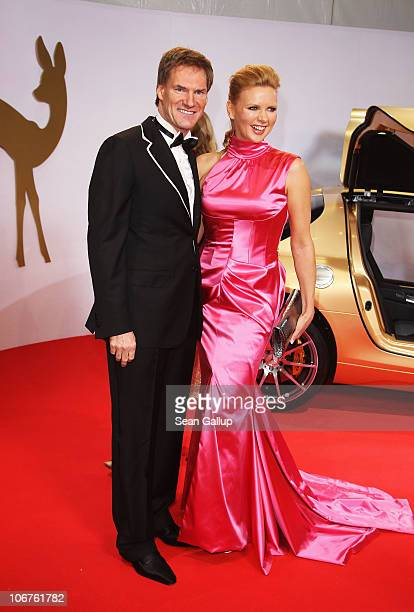 Veronica Ferres in dress by GUIDO MARIA KRETSCHMER and Carsten Maschmeyer arrive for the Bambi 2010 Award at Filmpark Babelsberg on November 11 2010...