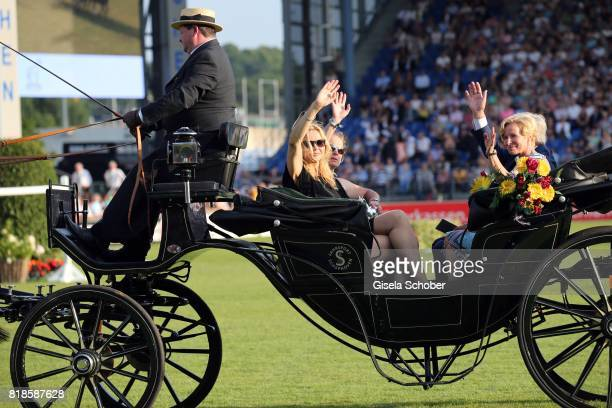 Veronica Ferres Isabell Werth and Nadine Capellmann in a carriage during the media night of the CHIO 2017 on July 18 2017 in Aachen Germany