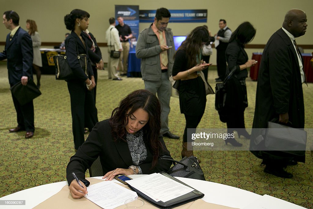 Veronica Floyd fills out a job application at a National Career Fairs job fair in Arlington, Virginia, U.S., on Wednesday, Jan. 30, 2013. The U.S. Labor Department is scheduled to release initial jobless claims data on Jan. 31. Photographer: Andrew Harrer/Bloomberg via Getty Images