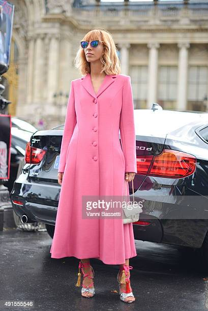 Veronica Giomini poses wearin a G2G coat before the Chanel show at the Grand Palais during Paris Fashion Week SS16 on October 6 2015 in Paris France