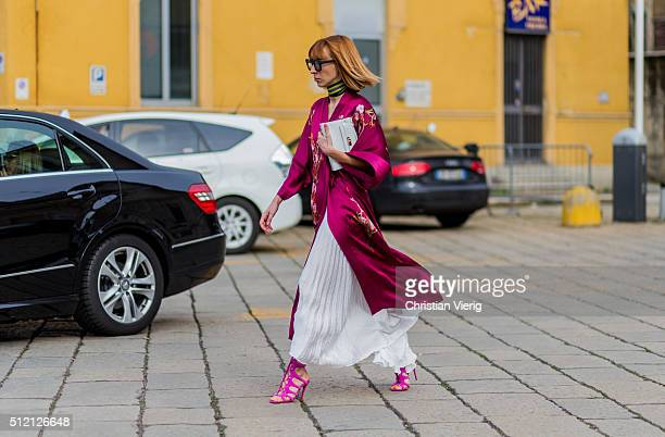 Veronica Giomini wearing Whezy Shelly kimono Messagerie skirt and Louboutin shoes seen outside Gucci during Milan Fashion Week Fall/Winter 2016/17 on...