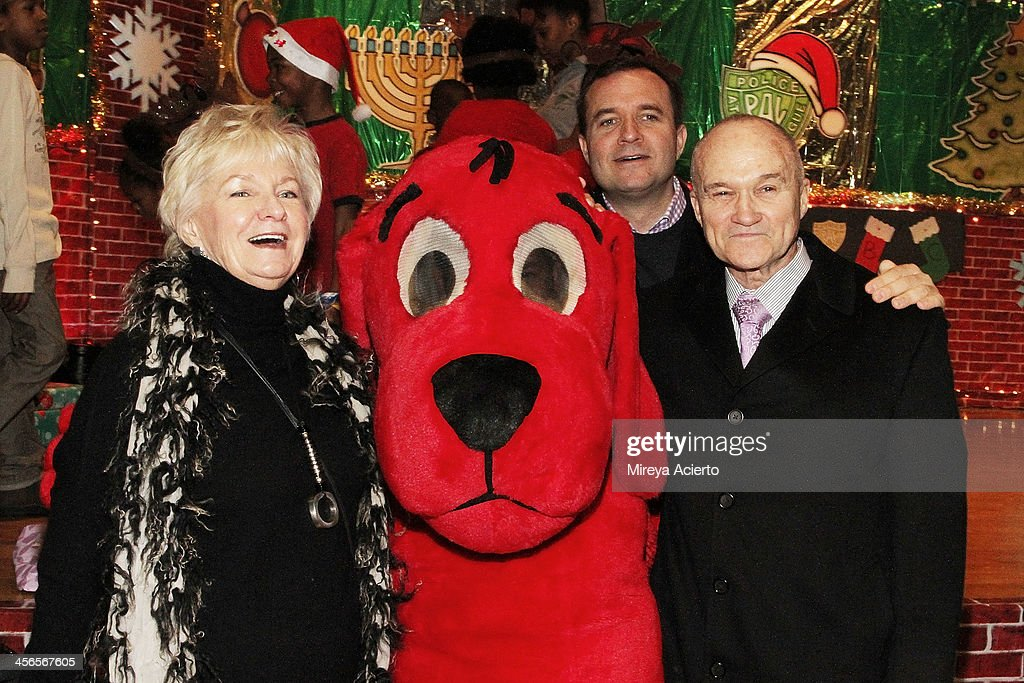 Veronica Kelly, Clifford the Dog, broadcast journalist Greg Kelly and Commissioner of New York Raymond Kelly attend CitySightseeing New York 2013 holiday toy drive at PAL's Harlem Center on December 14, 2013 in New York City.