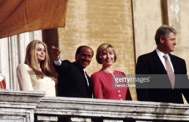 Veronica Lario Italian Prime Minister Silvio Berlusconi Fist Lady Hillary Clinton and 42nd President of the United States Bill Clinton wave from the...