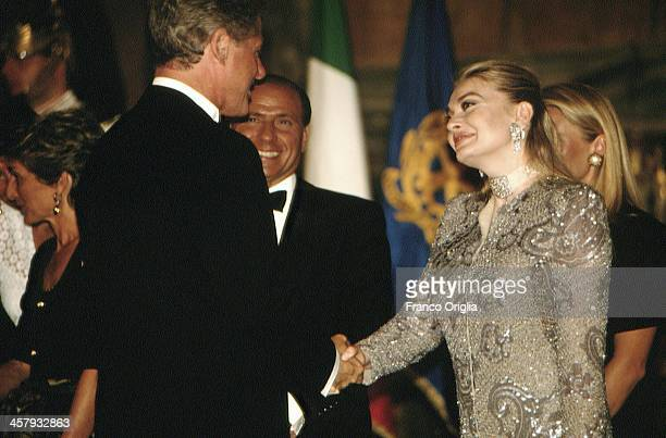 Veronica Lario Second wife of Italian Prime Minister Silvio Berlusconi shakes hands with 42nd President of the United States Bill Clinton at the...