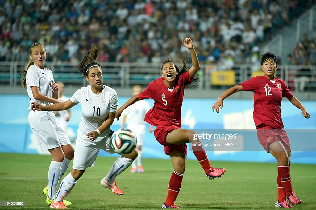 Veronica Mikolajova of Slovakia clashes with Xie Qiwen of China during the 2014 FIFA Girls Summer Youth Olympic Football Tournament Semi Final match between China and Slovkia at Wutaishan Stadium on August 23, 2014 in Nanjing, China.