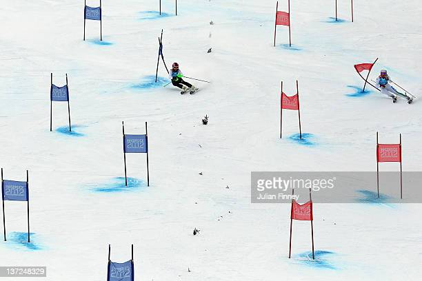 Veronica Olivieri of Italy and Alisa Krauss of Germany race in the Alpine Skiing Parallel Team Event during the Winter Youth Olympic Games on January...