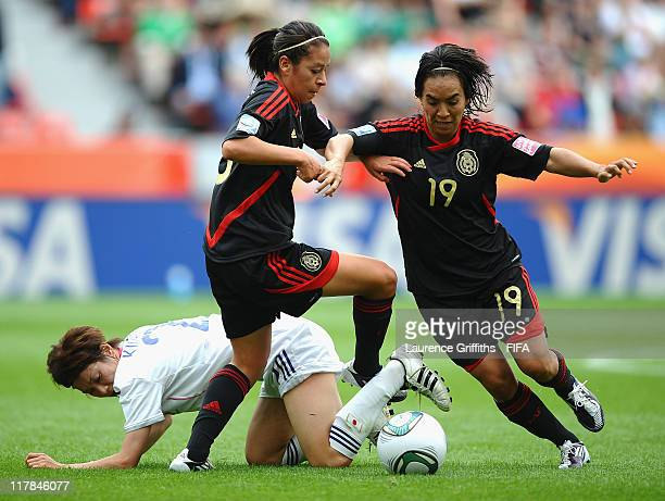 Veronica Perez and Monica Ocampo of Mexico battle with Yukari Kinga of Japan during the FIFA Women's World Cup 2011 Group B match between Japan and...