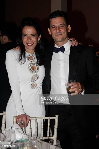 Veronica Serra and Marco Raduan attend the 5th Annual amfAR Inspiration Gala at the home of Dinho Diniz on April 10 2015 in Sao Paulo Brazil