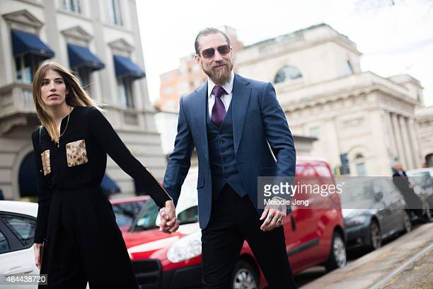 Veronika Heilbrunner and Justin O'Shea enter the Gucci show Veronika wears Salvatore Ferragamo with a Louis Vuitton purse Justin wears a Doyle Mueser...