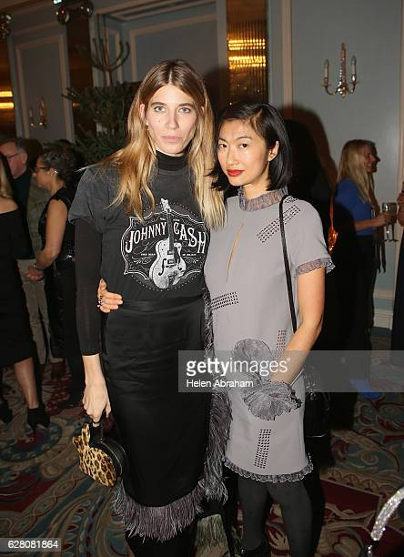 Veronika Heilbrunner and Mimi Xu attend the mytheresacom X Christopher Kane Christmas cocktail at The Lanesborough Hotel on December 6 2016 in London...