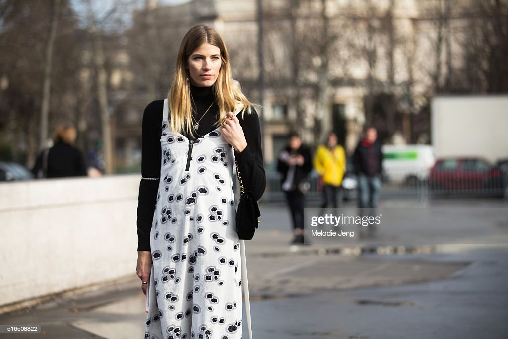 Veronika Heilbrunner of Hey Woman wears a Ellery slip print dress and a Chanel purse at the Chanel show at Grand Palais on March 07 2016 in Paris...