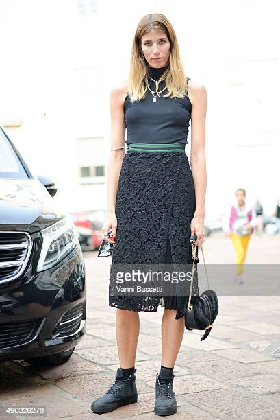 Veronika Heilbrunner poses wearing a Ferragamo skirt and bag before the Salvatore Ferragamo show during the Milan Fashion Week Spring/Summer 16 on...