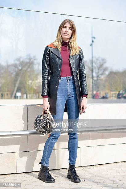 Veronika Heilbrunner poses wearing a Louis Vuitton coat and bag and Dr Martens shoes on Day 9 of Paris Fashion Week Womenswear FW15 on March 11 2015...