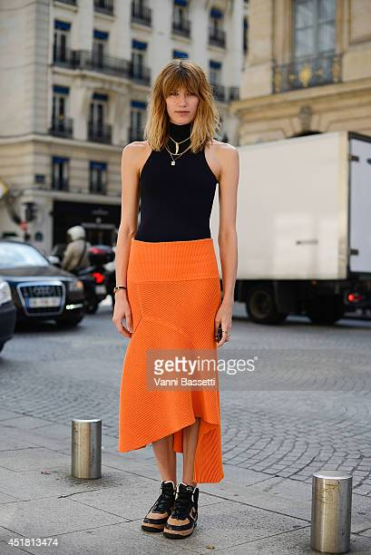 Veronika Heilbrunner poses wearing an Acne dress and Nike sneakers after Schiapparelli show on July 7 2014 in Paris France