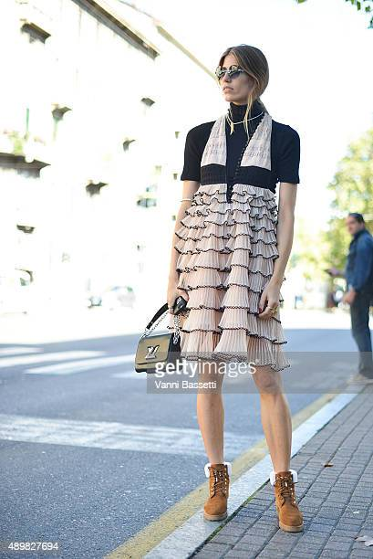 Veronika Heilbrunner poses wearing an Alexander McQueen dress and Louis Vuitton bag before the Emilio Pucci show during the Milan Fashion Week...
