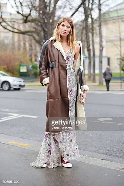 Veronika Heilbrunner poses wearing an Alexander McQueen dress and Converse shoes before the Chanel show at the Grand Palais during Haute Couture on...