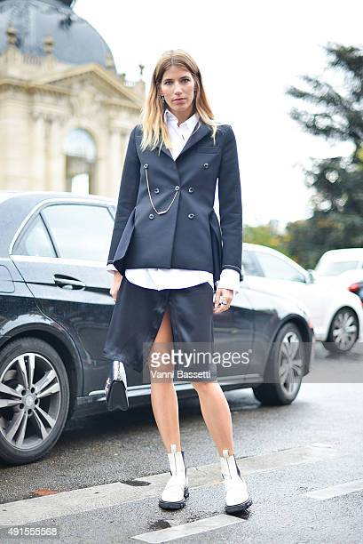 Veronika Heilbrunner poses wearing an Ellery jacket Acne Studios skirt and Zara shoes before the Chanel show at the Grand Palais during Paris Fashion...