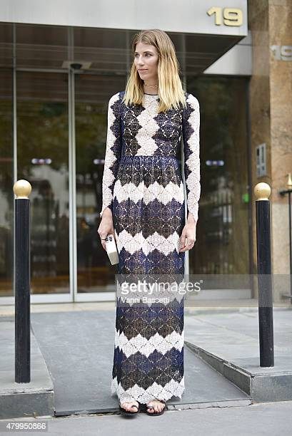 Veronika Heilbrunner poses wearing an Erdem dress before the Fendi show at the Theatre des Champs Elysees on July 8 2015 in Paris France