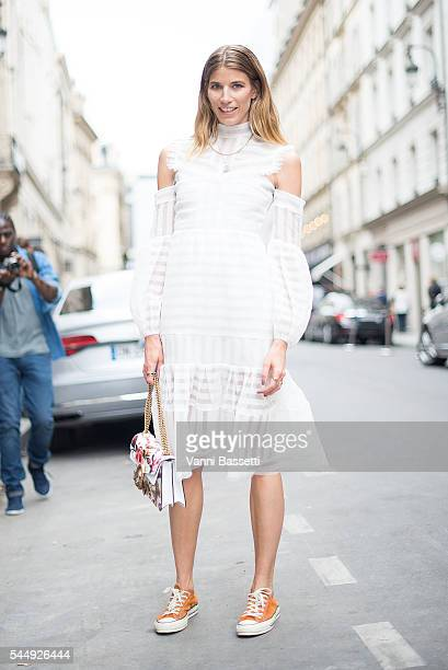 Veronika Heilbrunner poses wearing Converse shoes before the Brioni show in Rue Saint Honore during Paris Fashion Week Haute Couture FW 16/17 on July...