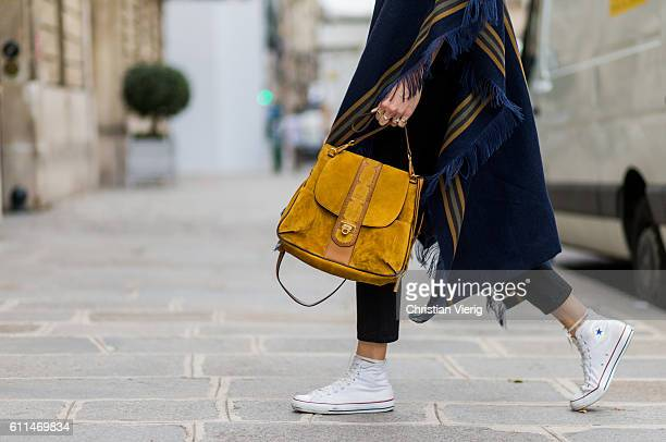 Veronika Heilbrunner wearing a Chloe poncho Chloe Lexa bag and Converse sneaker outside Chloe on September 29 2016 in Paris France