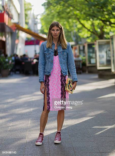 Veronika Heilbrunner wearing a pink Lala Berlin dress and Levis denim jacket and red Converse chucks outside Lala Berlin during the MercedesBenz...