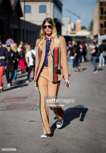 Veronika Heilbrunner wearing brown Gucci suit is seen outside Gucci during Milan Fashion Week Spring/Summer 2018 on September 20 2017 in Milan Italy