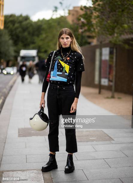 Veronika Heilbrunner wearing cropped black denim jeans helemt outside Christopher Kane during London Fashion Week September 2017 on September 18 2017...