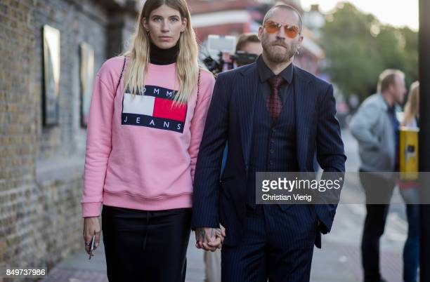 Veronika Heilbrunner wearing pink sweater and Justin O'Shea outside Tommy Hilfiger during London Fashion Week September 2017 on September 19 2017 in...