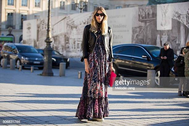 Veronika Heilbrunner wears a floor sweeping Dice Kayek floral dress leather jacket and YSL purse at the Schiaparelli show at Place Vendome on January...