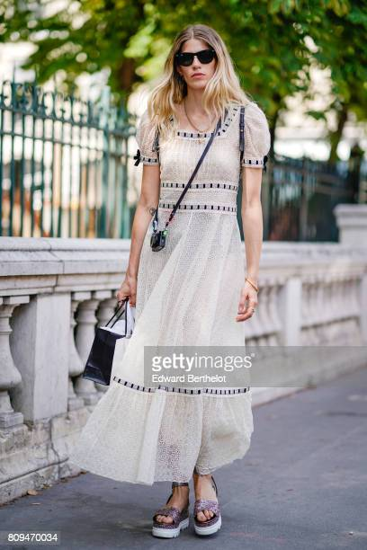 Veronika Heilbrunner wears sunglasses and a white lace dress outside the Jean Paul Gaultier show during Paris Fashion Week Haute Couture Fall/Winter...