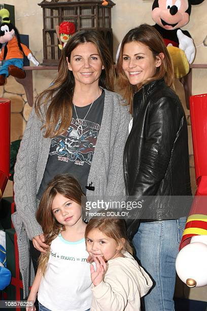 Veronika Loubry and Cecile Simeone and their children in Marne La Vallee France on November 05th 2005