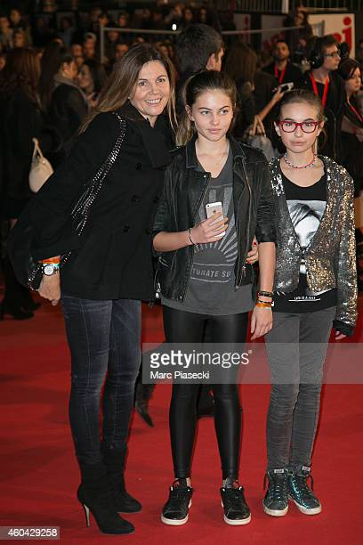 Veronika Loubry and children arrive to attend the '16th NRJ Music Awards 2014' ceremony at Palais des Festivals on December 13 2014 in Cannes France
