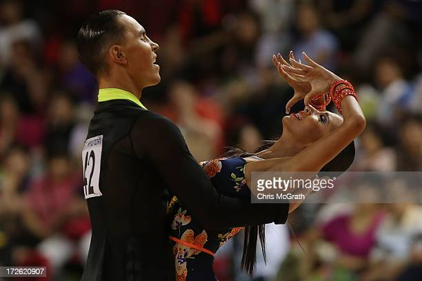 Veronika Popova and partner Maxim Antipin of Kazakhstan compete in the Dancesport Latin Five Dances Final at Samsan World Gymnasium during day 6 of...