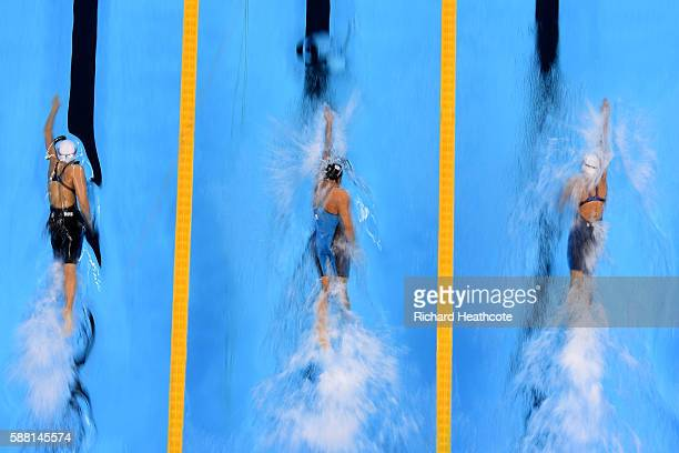 Veronika Popova of Russia Erika Ferraioli of Italy and Katarzyna Wilk of Poland compete in the Women's 100m Freestyle heat on Day 5 of the Rio 2016...