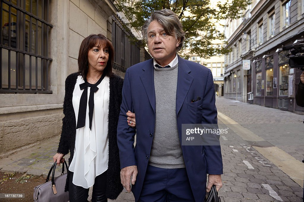 Veronique Cremault (L), mother of Valentin, arrives at the Lyon courthouse with her lawyer Gilbert Collard on November 12, 2013, before the appeal trial of Stephane Moitoiret and Noëlla Hego accused of the murder in 2008 of her ten-year old son. Moitoret and Hego were respectively sentenced in 2011 to life imprisonment and 18 years in prison.