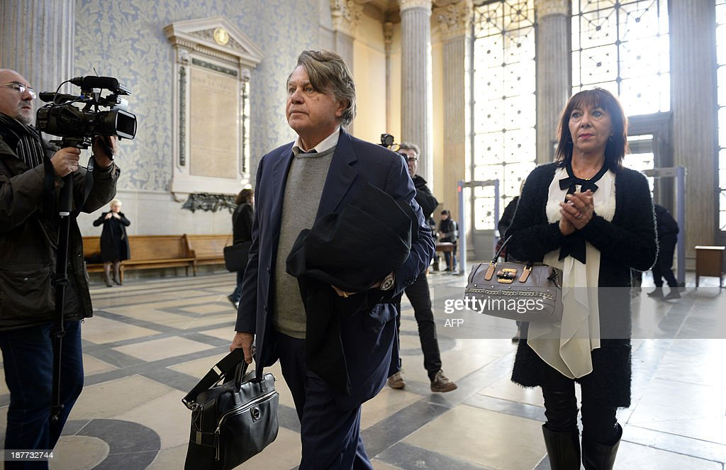 Veronique Cremault (R), mother of Valentin, arrives at the Lyon courthouse with her lawyer Gilbert Collard on November 12, 2013, before the appeal trial of Stephane Moitoiret and Noëlla Hego accused of the murder in 2008 of her ten-year old son. Moitoret and Hego were respectively sentenced in 2011 to life imprisonment and 18 years in prison. AFP PHOTO/PHILIPPE DESMAZES