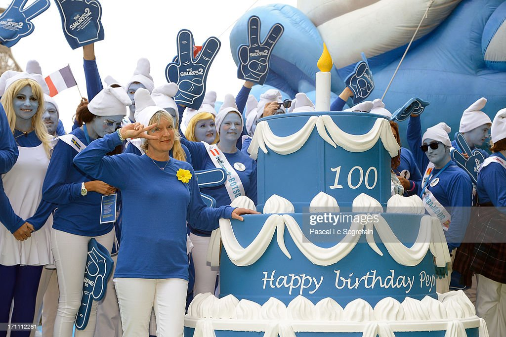 Veronique Culliford, foreground, the daughter of late cartoonist Peyo, the creator of The Smurfs, participates to celebrations as part of Global Smurfs Day on June 22, 2013 in Paris, France.