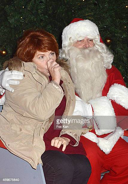 Veronique Genest and 'Santa Claus' attend the 'Marche De Noel' Launch at Parvis De La Defense on November 27 2014 in Paris France