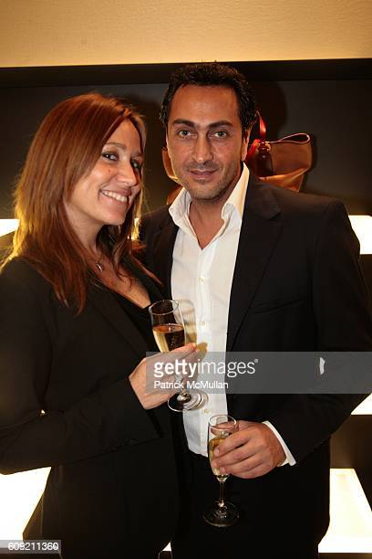 Veronique Habib and Herve Zerdoun attend Valentino and Holly Robinson Peete Rodney Peete host cocktail shopping event with wives of the NFL players...