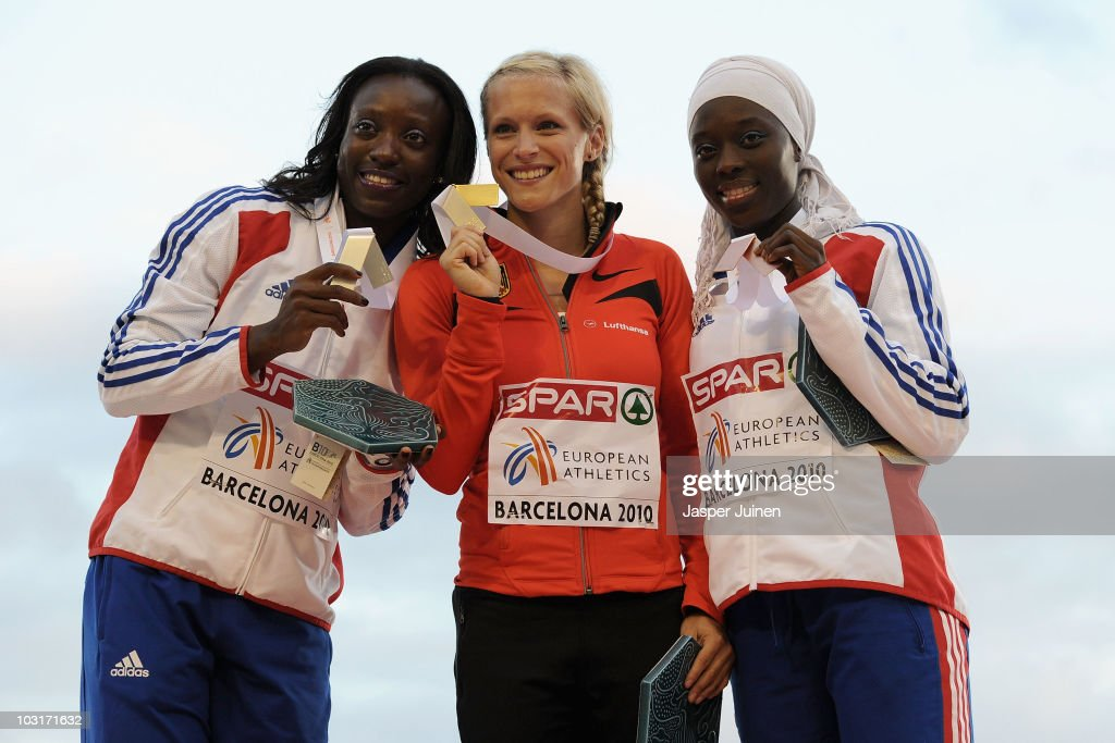 <a gi-track='captionPersonalityLinkClicked' href=/galleries/search?phrase=Veronique+Mang&family=editorial&specificpeople=774262 ng-click='$event.stopPropagation()'>Veronique Mang</a> of France receives the silver medal, <a gi-track='captionPersonalityLinkClicked' href=/galleries/search?phrase=Verena+Sailer&family=editorial&specificpeople=740560 ng-click='$event.stopPropagation()'>Verena Sailer</a> of Germany receives the gold medal and <a gi-track='captionPersonalityLinkClicked' href=/galleries/search?phrase=Myriam+Soumare&family=editorial&specificpeople=5499796 ng-click='$event.stopPropagation()'>Myriam Soumare</a> of France receives the bronze medal in the Womens 100m during day four of the 20th European Athletics Championships at the Olympic Stadium on July 30, 2010 in Barcelona, Spain.