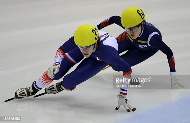 Veronique Pierron of France competes infront of EunByul Lee of Korea during the women's 1500m heat race of the ISU World Cup short track speed...