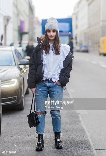 Veronique Sophie Schroeter wearing Acne beanie down feahter jacket ripped denim jeans fishnet tights at Marina Hoermanseder during the MercedesBenz...