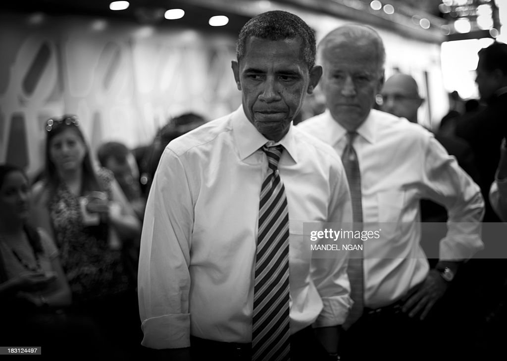 B/W version - US President Barack Obama and US Vice President Joe Biden (R) arrive to order lunch at Taylor Gourmet Deli on Pennsylvania Ave in Washington, DC on October 4, 2013. Obama walked over to the deli with US Vice President Joe Biden and ordered sandwiches to go. Mandel NGAN