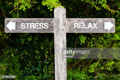 STRESS versus RELAX directional signs : Stock Photo