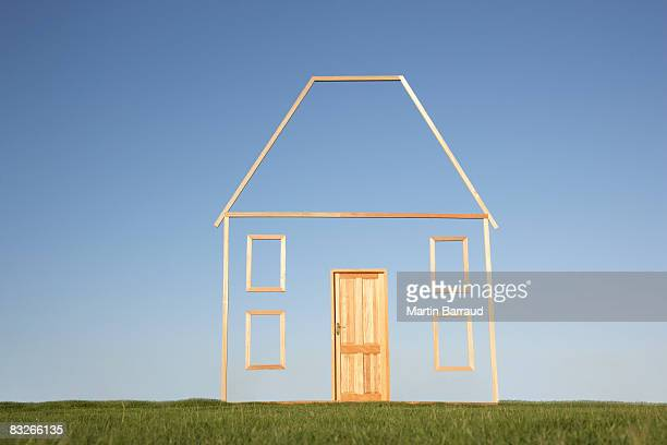 Vertical house outline in field