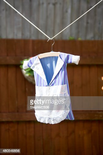 Vertical image of a peg holder on the washing line : Stock Photo