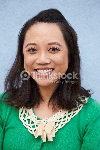Vertical Portrait Of Pretty 14 Year Old Girl Stock Image: Vertical Portrait Of Smiling Asian Woman Against Grey Wall