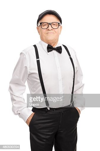 Vertical shot of a mature hipster in artistic clothes : Stock Photo