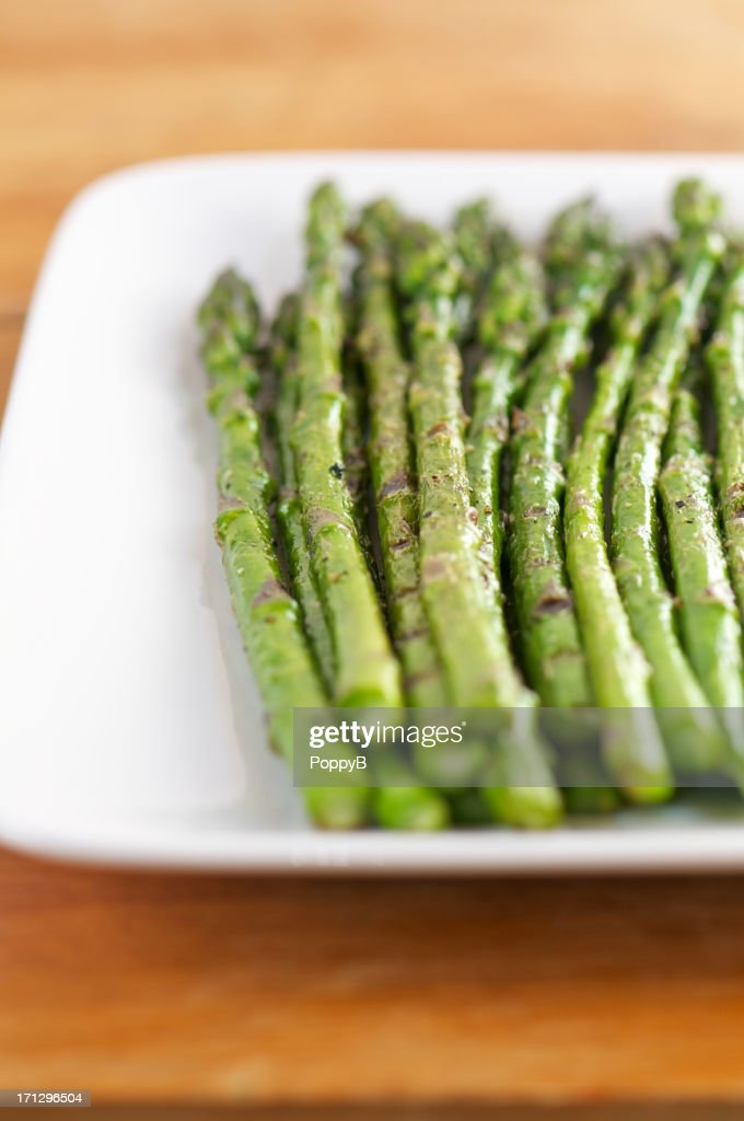 Vertical Shot of Grilled Asparagus on White Plate : Stock Photo
